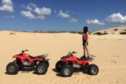 ATV on white sand dunes