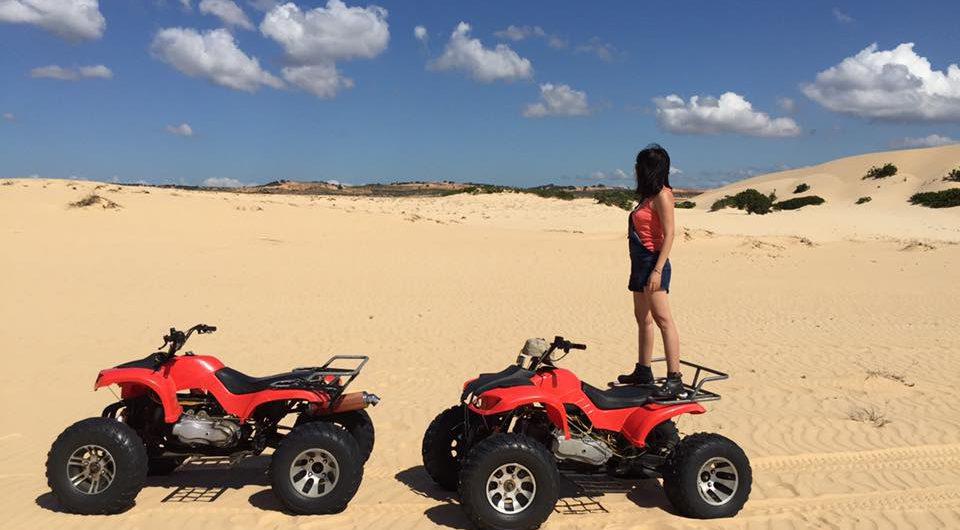 ATV on white sand dunes